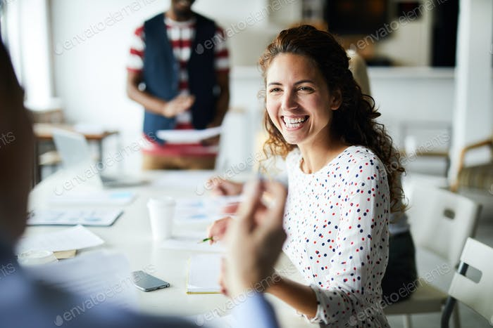 Happy businesswoman at meeting