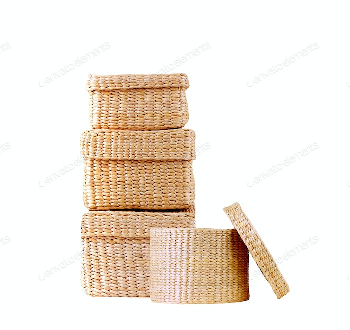 isolated round woven straw basket
