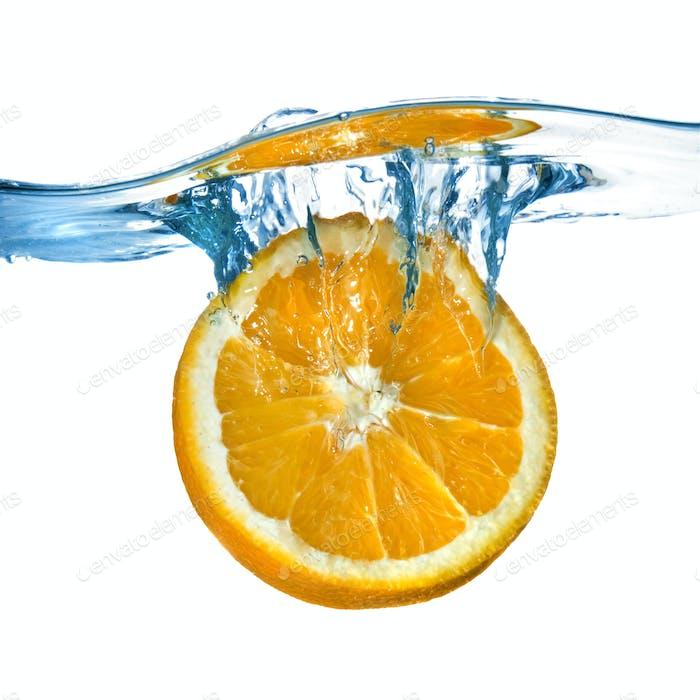 Fresh orange dropped into water with splash isolated on white