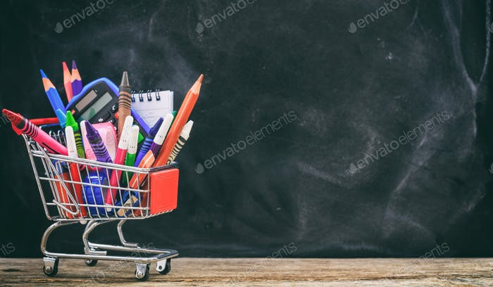 School shopping cart on blackboard background