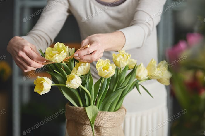 Woman decorating tulips