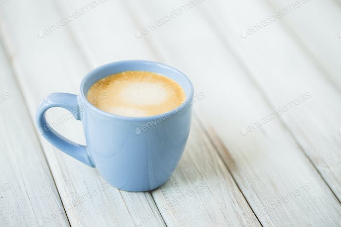 Coffee Latte cup top view on wooden table background