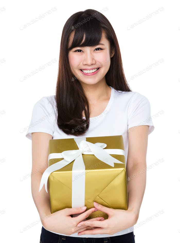 Young woman hold with big gift