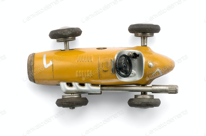 Vintage yellow toy racing car