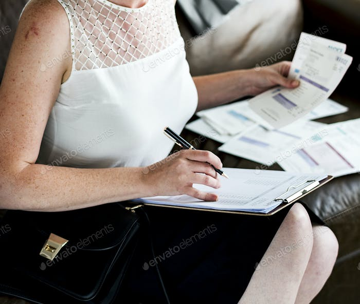 Businesswoman working on a couch