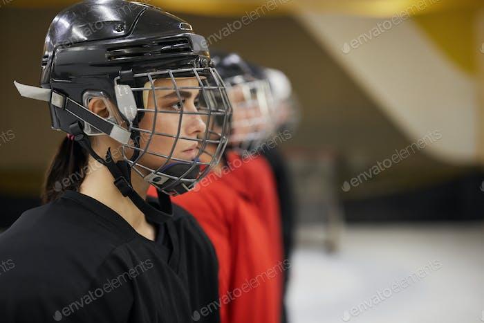 Female Hockey Team in Row