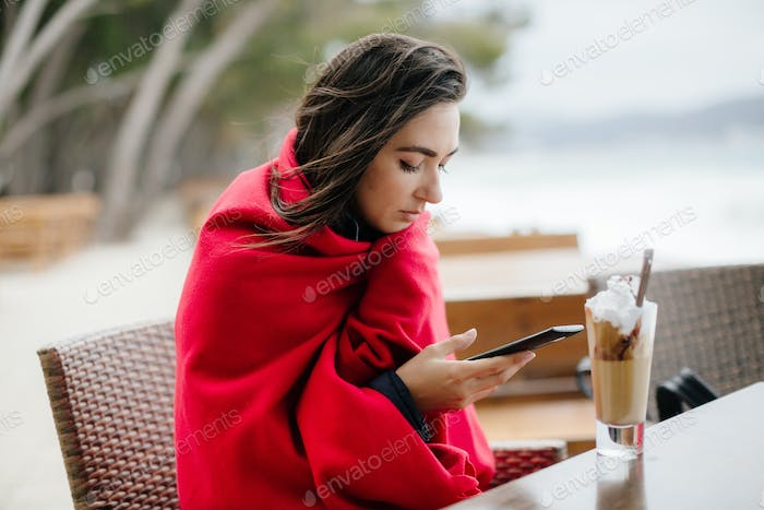woman using smartphone and drink coffee