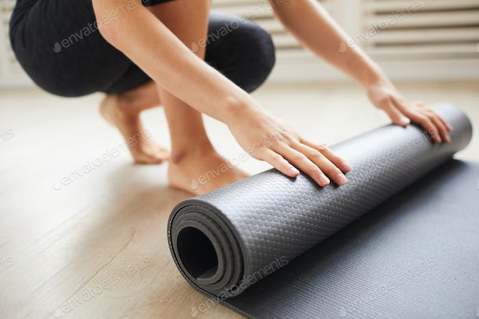 Woman with exercise mat