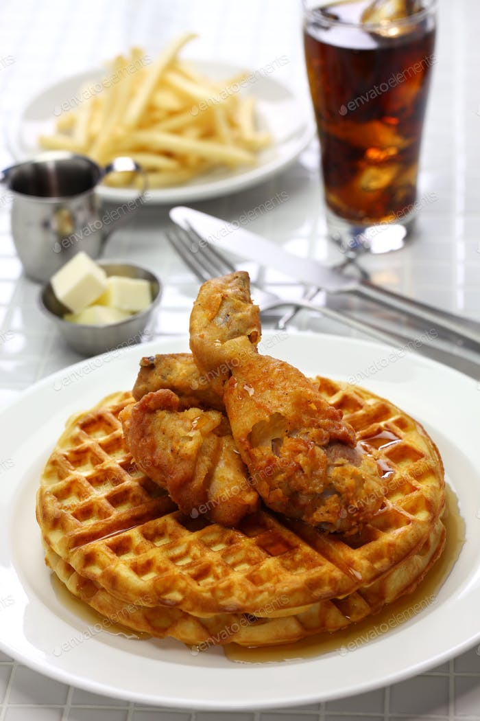 fried chicken and waffles with maple syrup