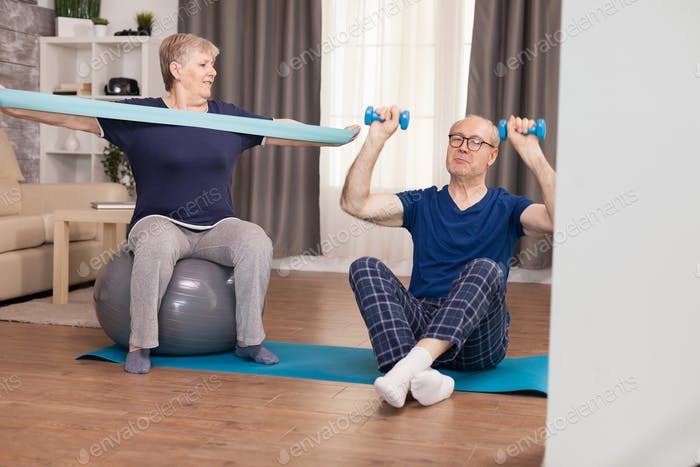 Elderly couple workout at home