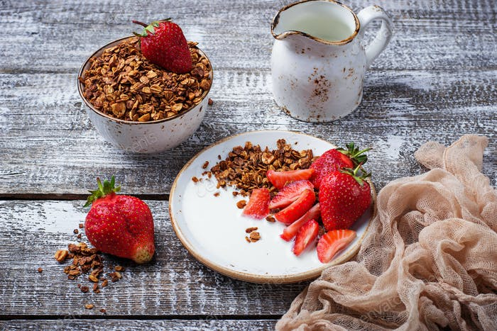 Granola with yogurt and strawberries