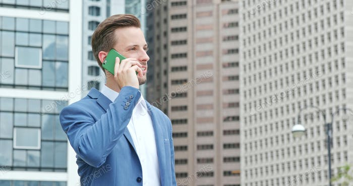 Businessman talk to mobile phone at outdoor