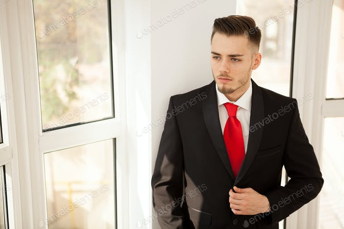Business man in suit in office building interior