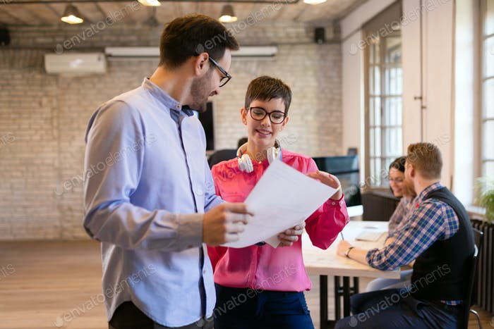 Young attractive architects discussing in modern office
