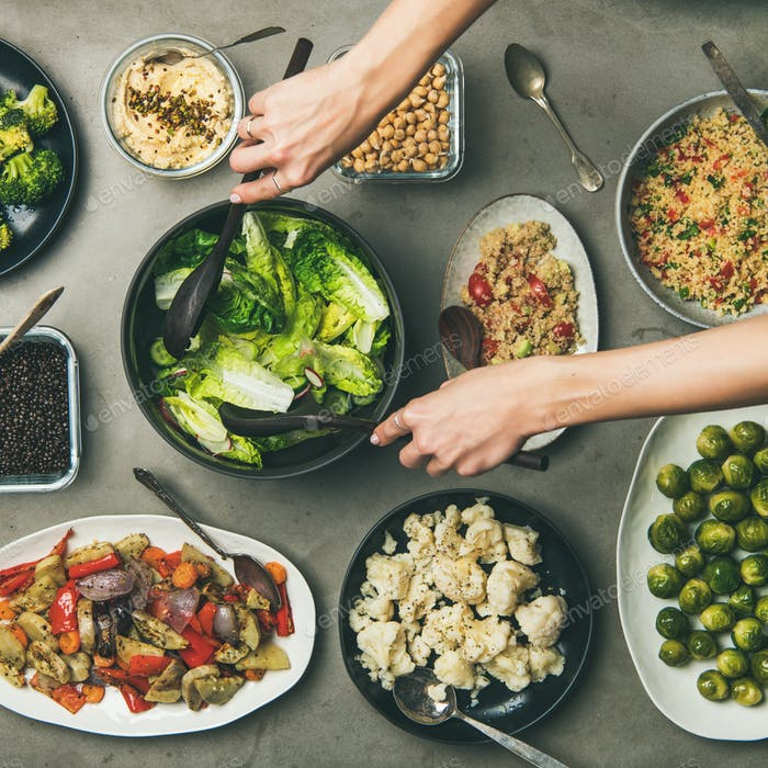 Healthy vegan dishes and woman hands taking salad, square crop