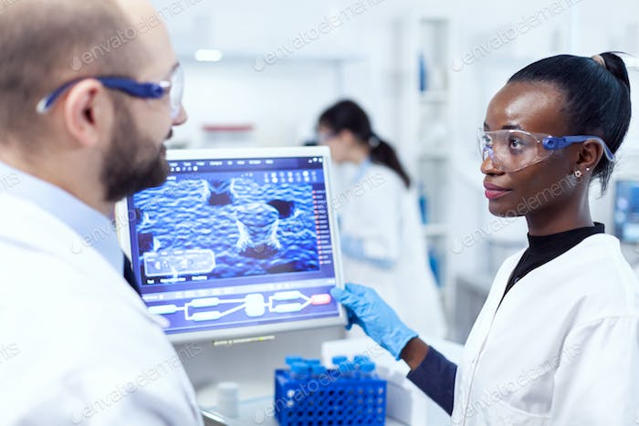 African scientist conducting chemistry experiment