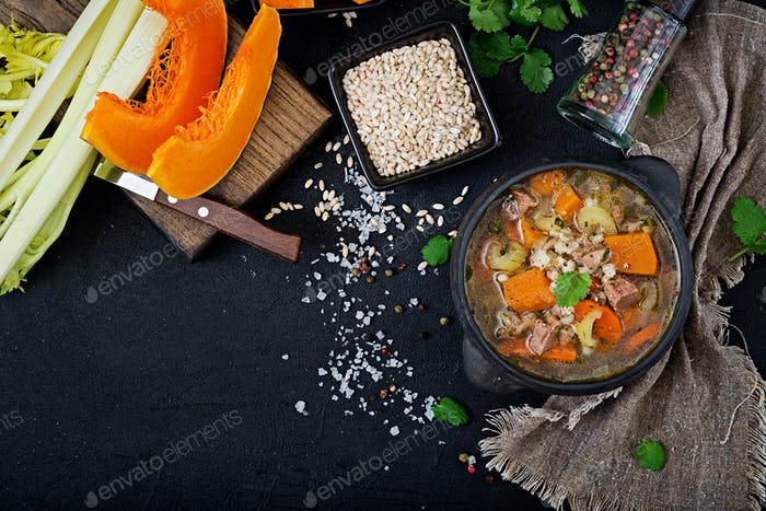 Thick soup with beef, pearl barley, pumpkin and celery. Dietary menu. Top view