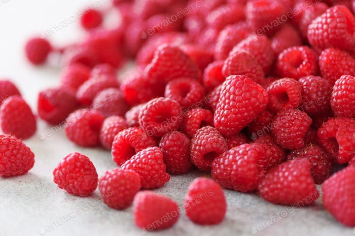 Fresh organic raspberries. Fruit background with copy space. Summer and berries harvest concept