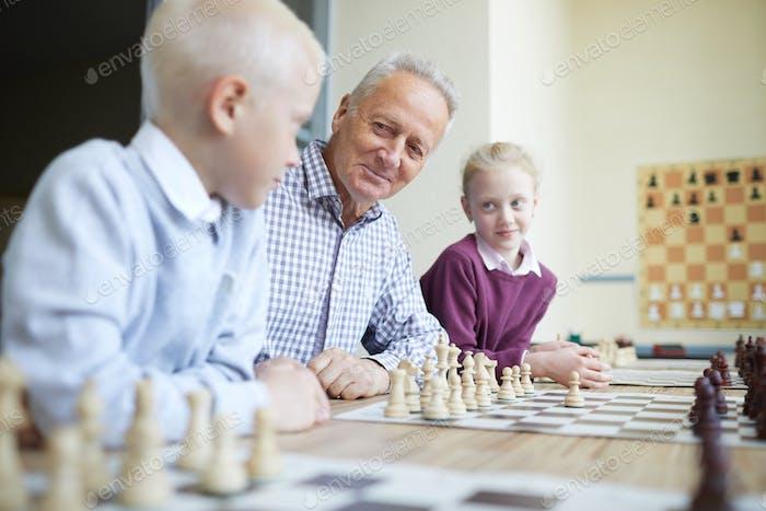 Grandfather teaching grandkids
