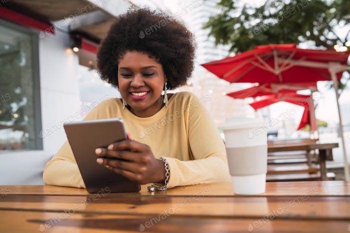 Afro american latin woman using digital tablet