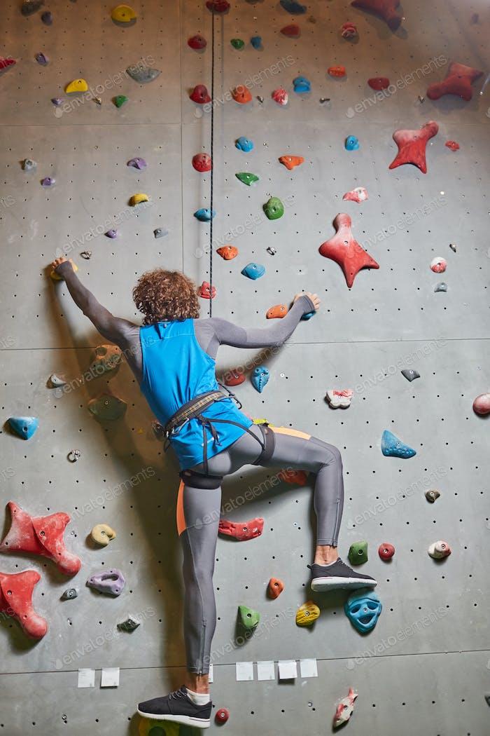 Guy climbing wall