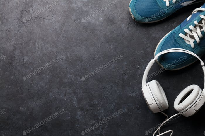 Fitness concept. Sneakers and headphones