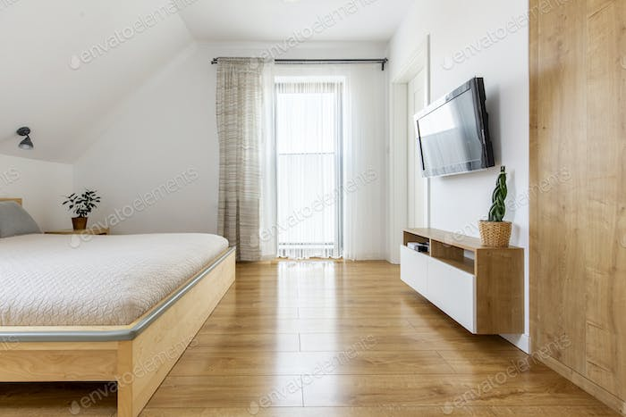 Real photo of a bright and spacious hotel bedroom interior with