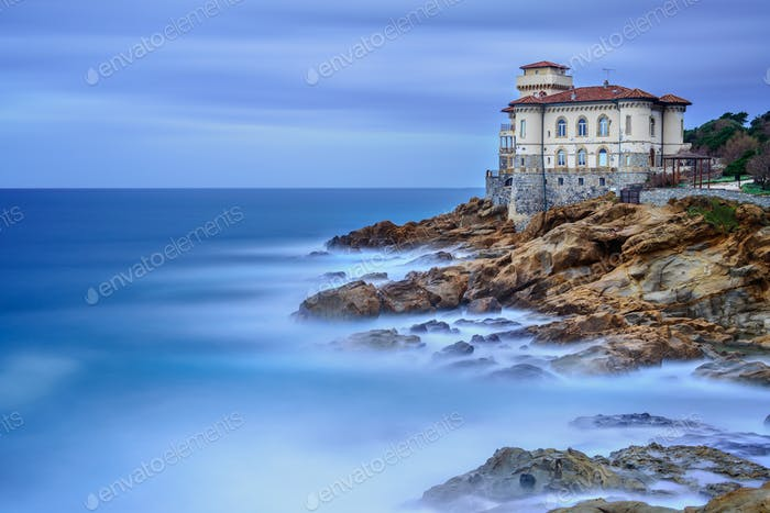 Boccale castle landmark on cliff rock and sea. Tuscany, Italy. Long exposure photography.