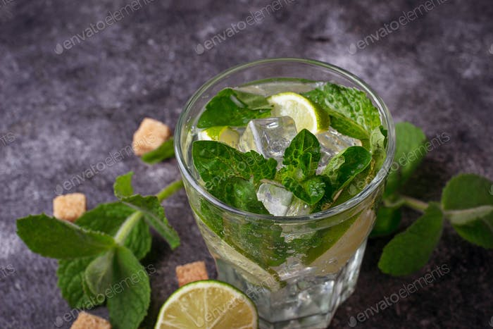 Summer drink mojito with rum, mint, ice and lime