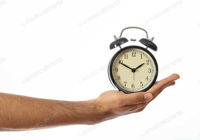 Alarm clock on a hand palm isolated on white background, clipping path