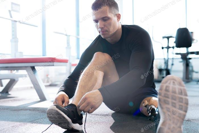 Handsome Adaptive Sportsman Tying Shoe