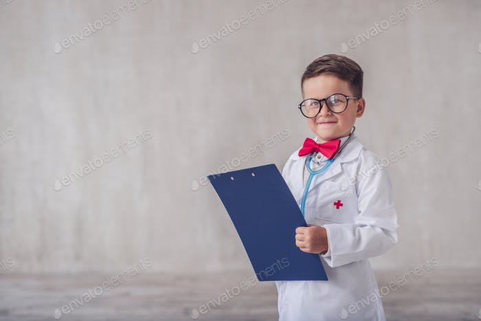 Smiling child with a clipboard