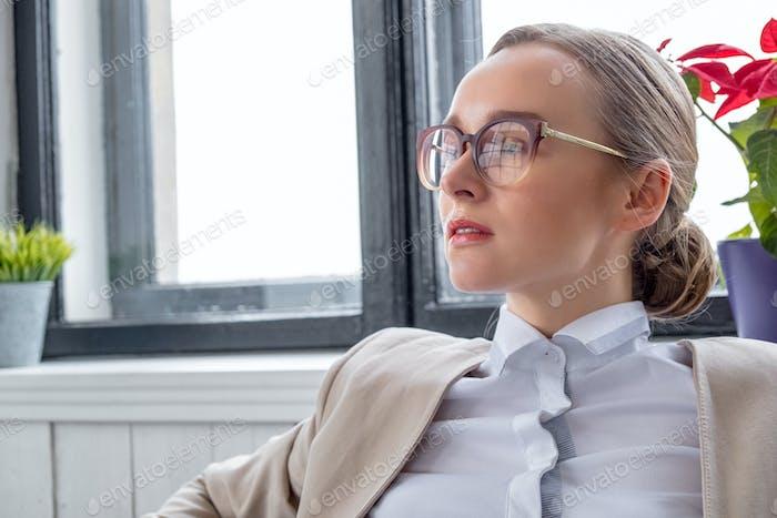 Portrait of a woman in eyeglasses.