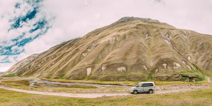 SUV Car On Off Road In Spring Mountains Landscape In Truso Gorge