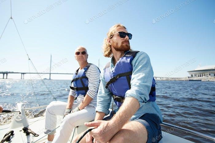 Dreamy men at sailing tour