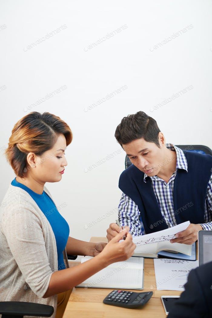 Serious Entrepreneur Showing Document