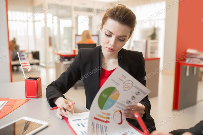 Pretty Businesswoman Reading Report