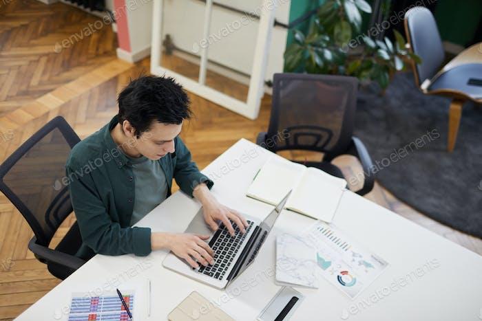 Businessman uisng laptop in work