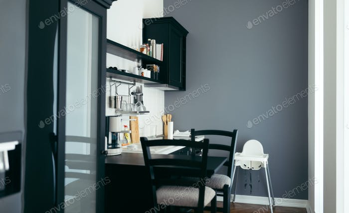 Modern kitchen with black table and chairs