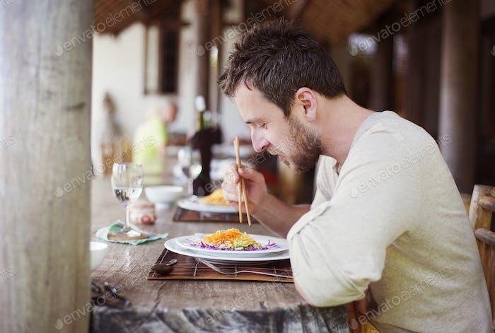 Man enjoying meal at vietnamese restaurant