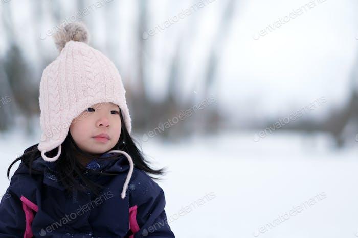Winter portrait of little child girl wearing knitted hat