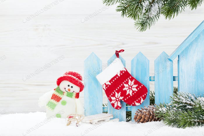 Christmas snowman toy, decor and fir tree branch