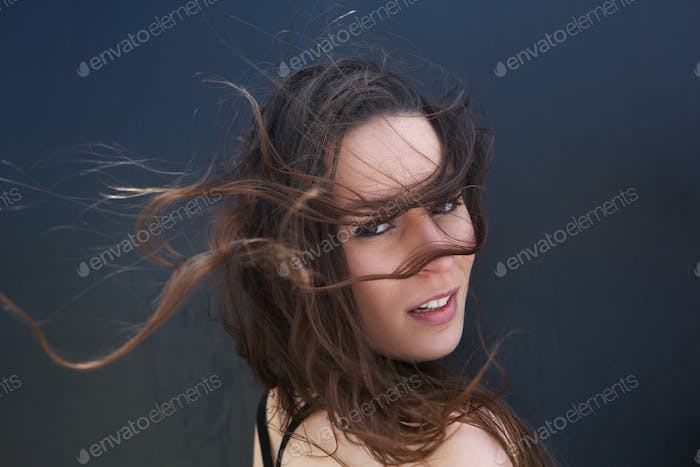 Female fashion model with hair blowing
