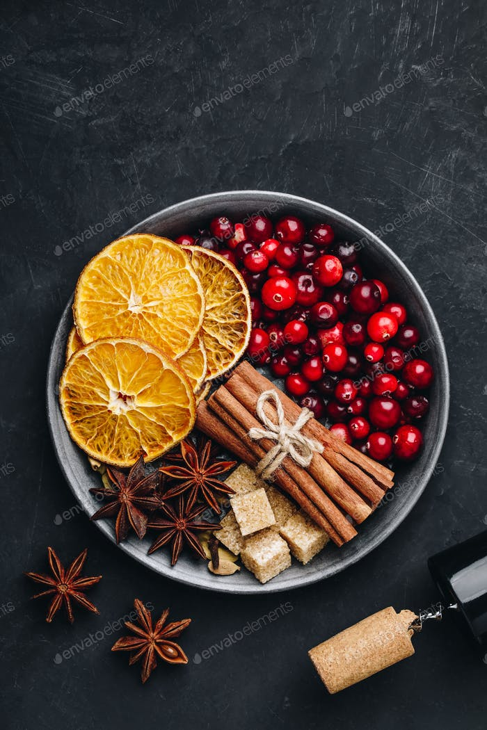 Mulled Wine Ingredients with cranberries, oranges, cinnamon, anise and cardamom