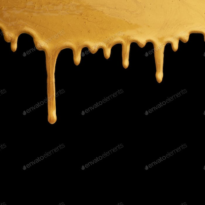 Gold paint dripping on black background, creative frame
