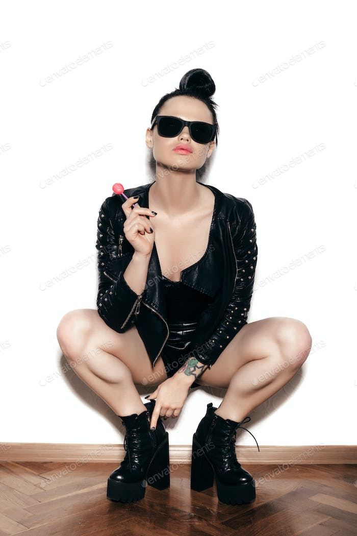Woman licking  red shiny lollipop