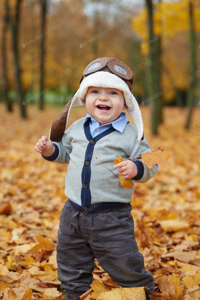 little boy in helmet pilot