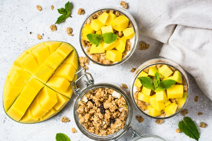 Parfait with yogurt, mango and granola top view