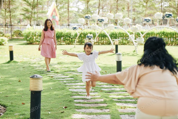 Girl running to grandmother