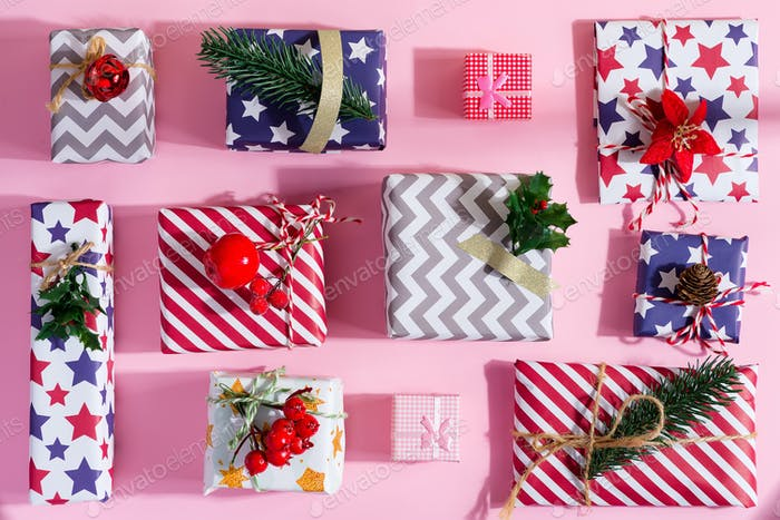 Greeting Christmas postcard with colorful gift boxes
